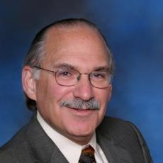 Bruce E. Genter MD, FACS